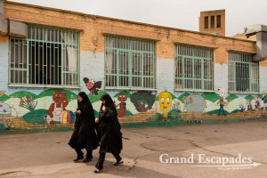 Women in Chador going along a kindergarden in Yazd, Kashan, Iran