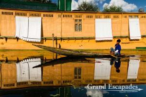 House Boats reflecting on the waters of Lake Dal, Srinagar, Kashmir, India