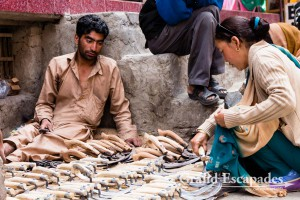 Man selling pruning knifes in the market of Leh, Ladakh, India