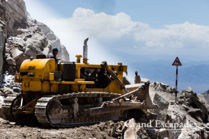 Road construction requires to blast some rocks from the mountain slope right at the pass - Here at Khardung La, we stayed 3 hours blocked at 5.602 meters - Ladakh, India