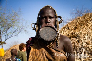 The most distinctive of all ethnic groups in the Omo Valley: the Mursi, famous for the huge Lip Plates the women are sporting. Mago National Park, near Jinka, Lower Omo Valley, South Ethiopia