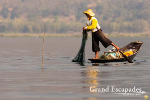 Fishermen on Inle Lake, Myanmar - Them rowing their boats with one leg contributed to making the lake a legend. This technique allows them to throw / pull their nets with both hands.