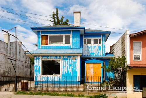 Punta Arenas, Patagonia, Chile - The more common sight here are houses made of wood with thin sheets of metals nailed onto them, then the building is painted in the wildest colour