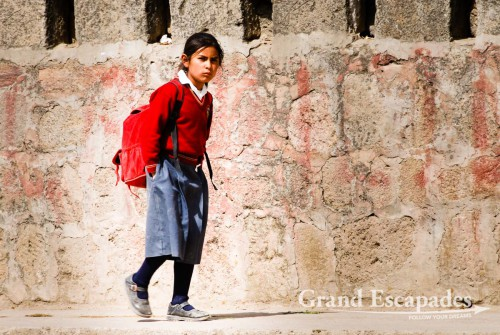 Younf girl coming back from school, Cabanaconde, Peru