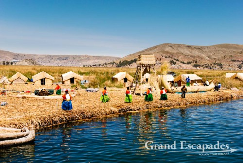 Approaching one of the show-case islands for tourists! - Uros Floating Islands, Lake Titicaca, Peru, South America