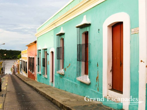 Colonial historic center, with colourful houses and tall window behind beautiful iron-works, Ciudad Bolivar, Venezuela