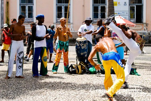 Capoeira dancers performing with their class on the street, Salvador de Bahia, Brazil
