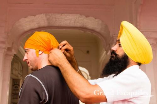 "Getting ready for the Harmandir Sahib (Punjabi: ਹਰਿਮੰਦਰ ਸਾਹਿਬ) or Darbar Sahib, also referred to as the ""Golden Temple"", a prominent Sikh Gurdwara or Sikh temple, Amritsar, Punjab, India"
