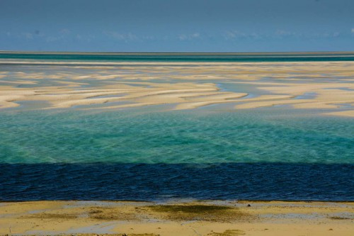 Vilankulos, during low tide the water retreats leaving sand bars and small pool of water in spetctacular colours - Picture by Jason Risley