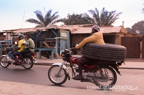 Man transporting tire